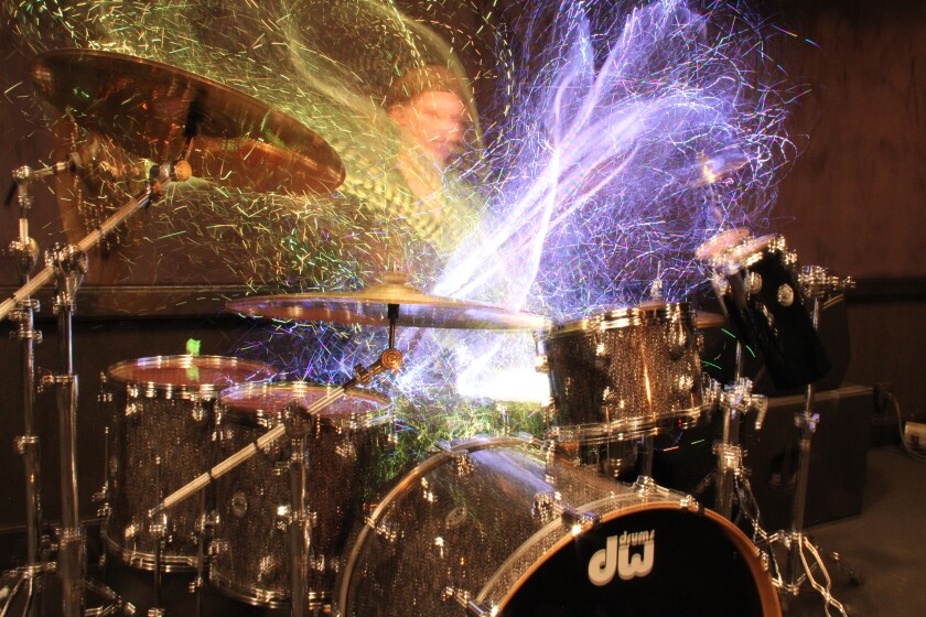 """Chad Smith's drumming can be seen in art pieces made from his drumming, through an open shutter photography technique described as """"rhythm on canvas,"""" for which he uses special illuminated drum sticks."""