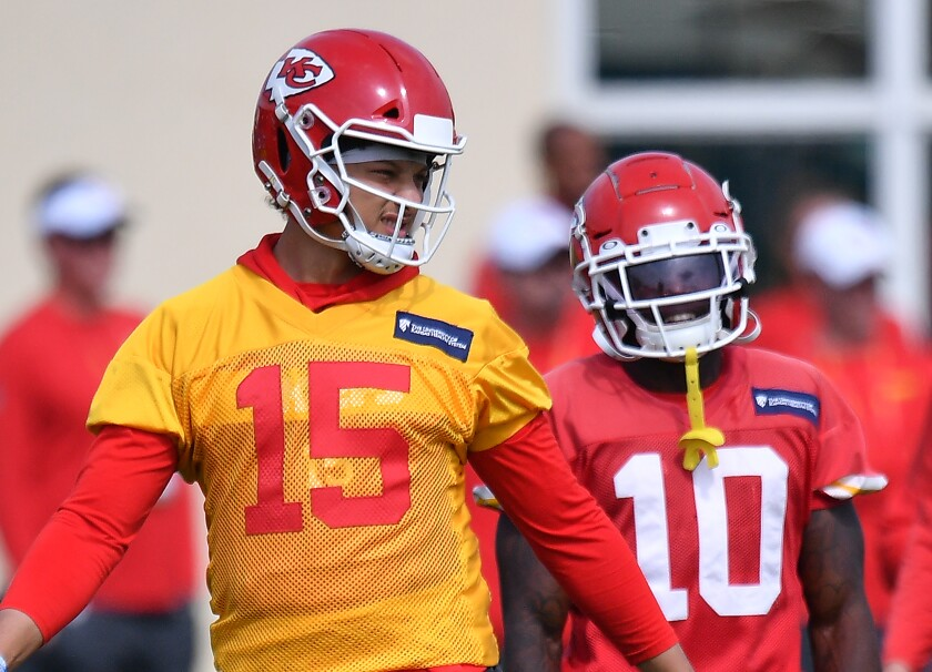 Kansas City Chiefs quarterback Patrick Mahomes, left, and wide receiver Tyreek Hill discuss a play.