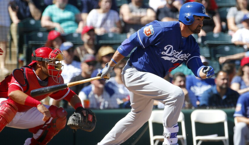 Los Angeles Dodgers' Adrian Gonzalez hits against the Los Angeles Angels during a spring training baseball game on March 9 in Tempe, Ariz.