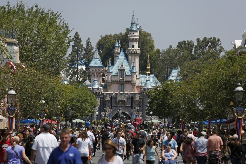 A study found that 73 percent of workers at Disneyland and California Adventure Park who were surveyed said they don't earn enough to pay for basic living expenses. Above, guests crowd Main Street in front of Sleeping Beauty Castle at Disneyland in June 2017.