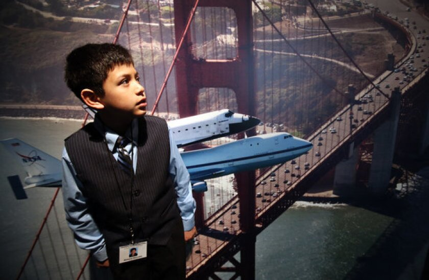 Richard Hercules, a fifth-grader at Century Park Elementary School, visiting an exhibition related to the space shuttle Endeavour at the California Science Center.