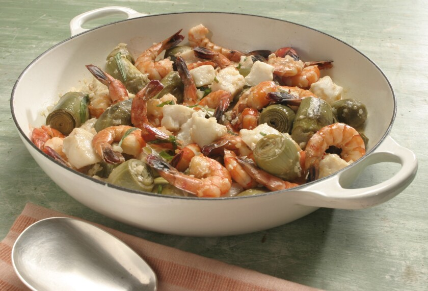 A seafood stew with grouper, shrimp and artichokes in tarragon cream.