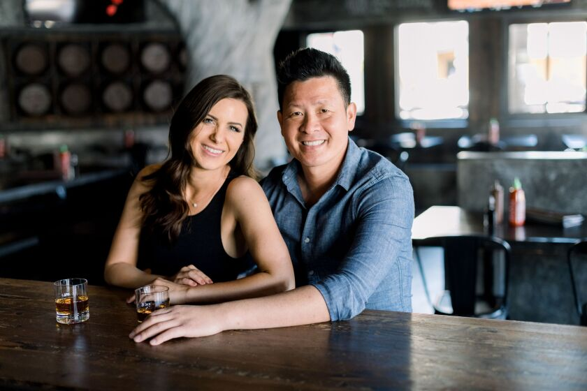 Brittany Merrill Yeng and Steven Yeng of Skrewball Whiskey Co. in Ocean Beach are donating up to $500,000 to a fund for laid-off bartenders.