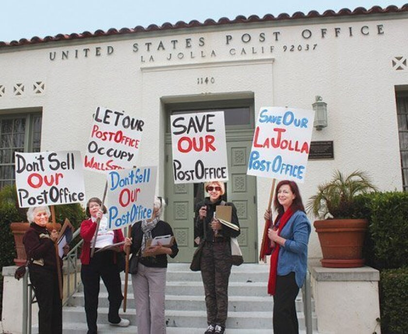 Members of the Save Our Post Office Task Force rally in front of the La Jolla post office on Wall Street. (La Jolla Light photo)