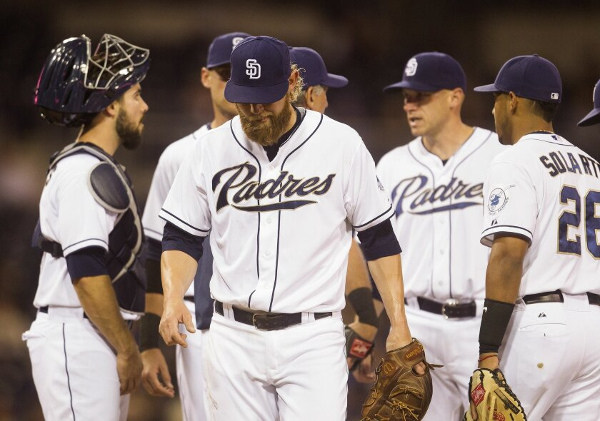 Padres starting pitcher Andrew Cashner (34) is taken out of the game against the Mets by Bud Black in the fifth inning.