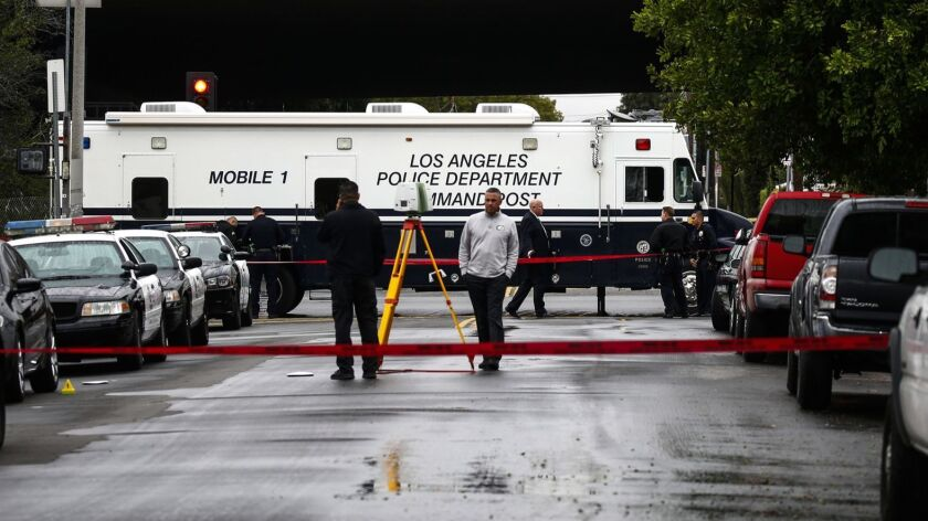 Police Officers at the scene of a fatal officer involved shooting near the 10900 block of Telfair Avenue in Pacoima.