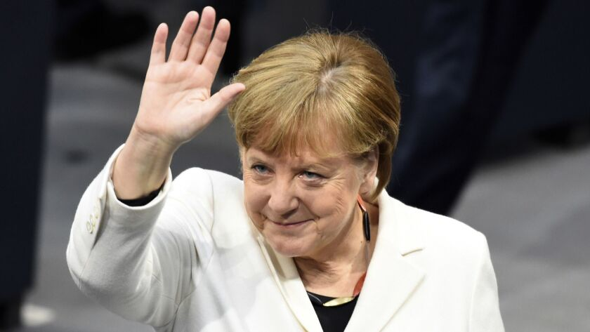 Chancellor Angela Merkel waves as Germany's Parliament Bundestag meets to elect her for a fourth term March 14 in Berlin.