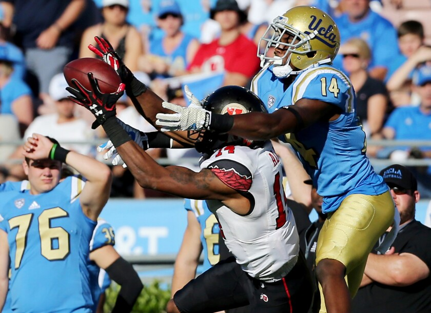 Utah cornerback Brian Allen intercepts a pass intended for UCLA wide receiver Theo Howard in the second half on Oct. 22.