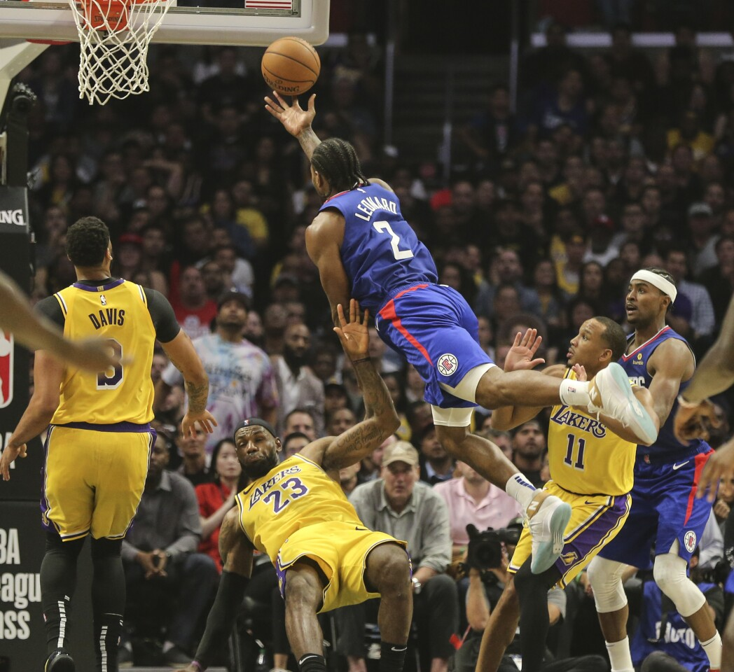 LOS ANGELES, CA, TUESDAY, OCTOBER 22, 2019 - LA Clippers forward Kawhi Leonard (2) charges into Los Angeles Lakers forward LeBron James (23) at Staples Center. (Robert Gauthier/Los Angeles Times)