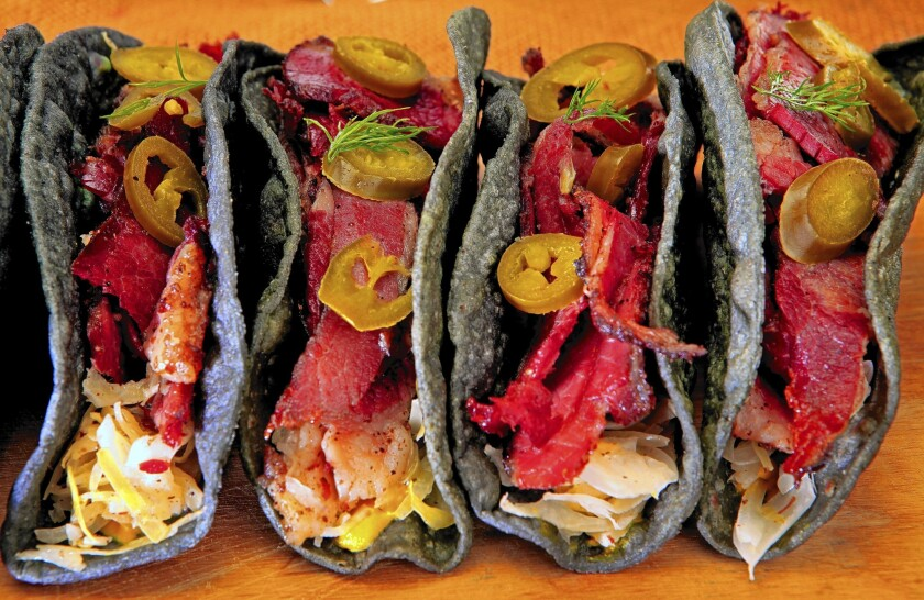 Pastrami tacos made with blue-corn tortillas.