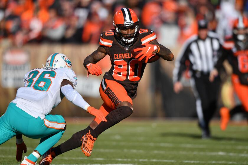 Cleveland Browns wide receiver Jarvis Landry tries to run past Miami Dolphins safety Adrian Colbert.