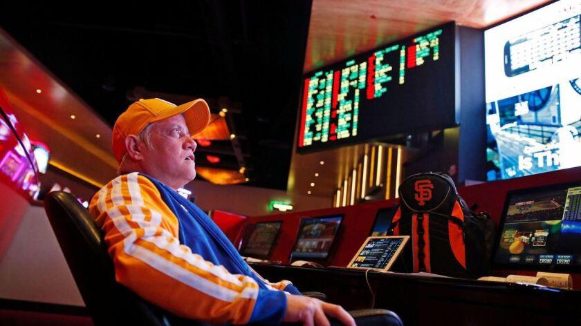 Amado Nanalang watches basketball games while making bets at a sports book in Las Vegas.