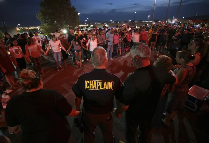 People attend a memorial in El Paso