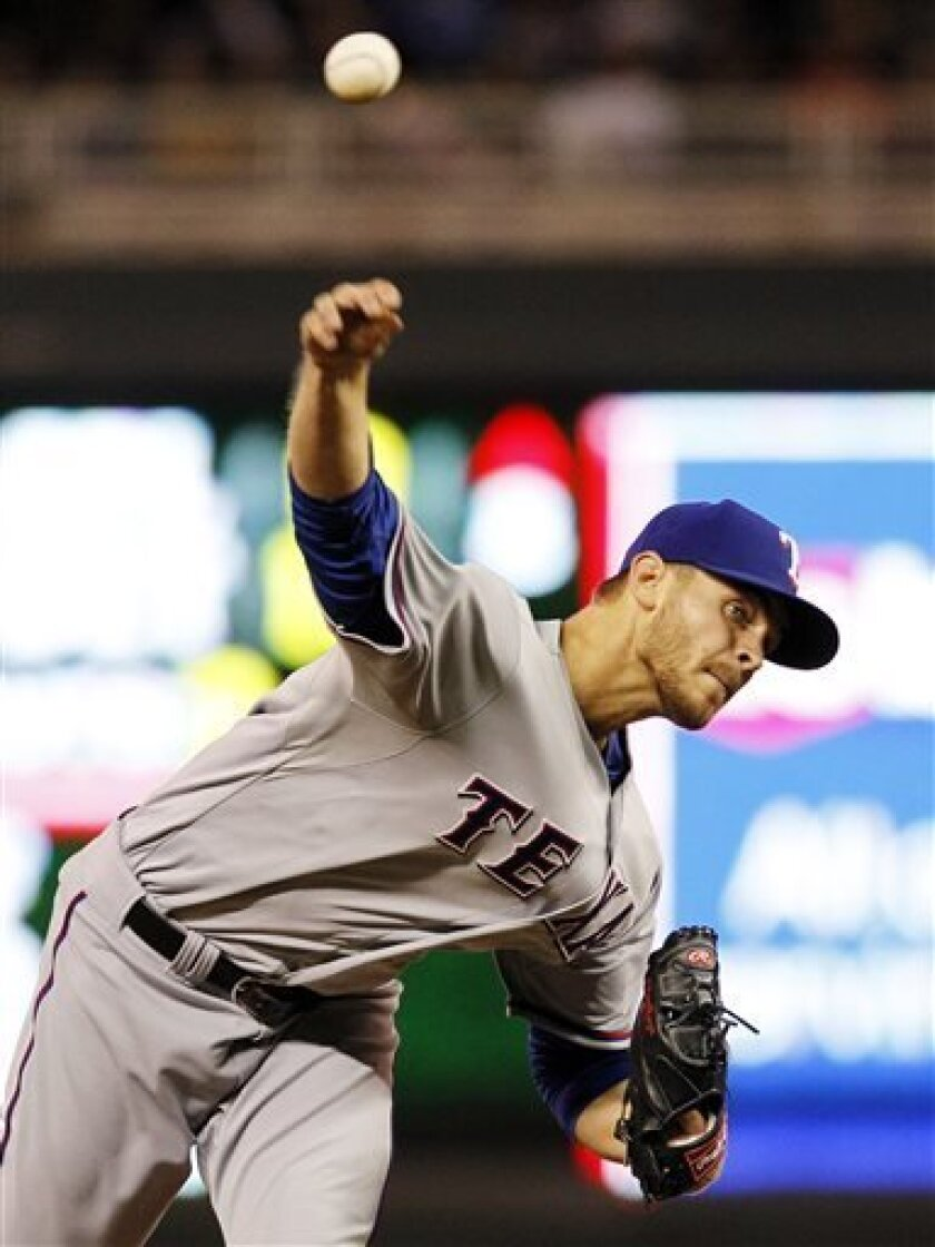 Texas Rangers starting pitcher Justin Grimm throws against the Minnesota Twins during the fifth inning of a baseball game on Friday, April 26, 2013, in Minneapolis. (AP Photo/Genevieve Ross)