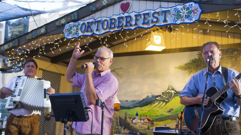 The German band Guggenbach-Baum performs for the Oktoberfest crowd as guests dance to their traditional music.