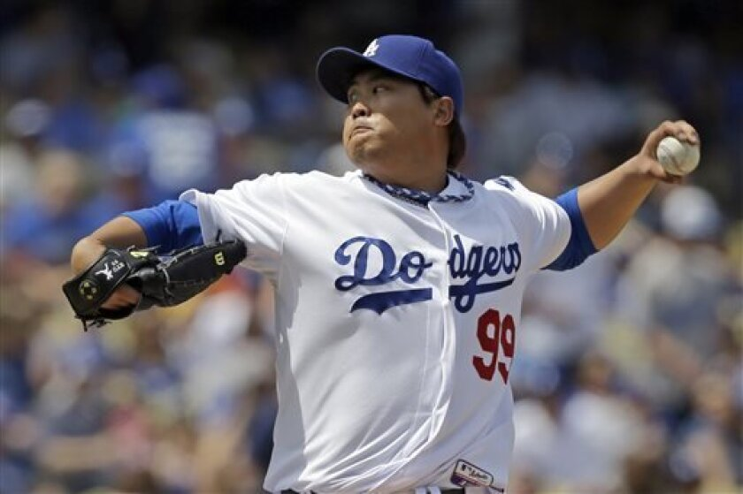 Los Angeles Dodgers starter Hyun-Jin Ryu, of South Korea, pitches to the Pittsburgh Pirates in the second inning of a baseball game in Los Angeles, Sunday, April 7, 2013. (AP Photo/Reed Saxon)