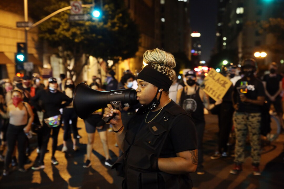 A protester speaks to the crowd during a protest in downtown LA before entering the 3rd Street tunnel.