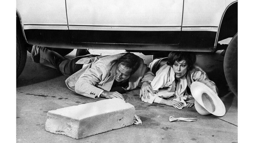 April 1974: Charlton Heston and Ava Gardner filming a scene in the movie Earthquake. This photo appe