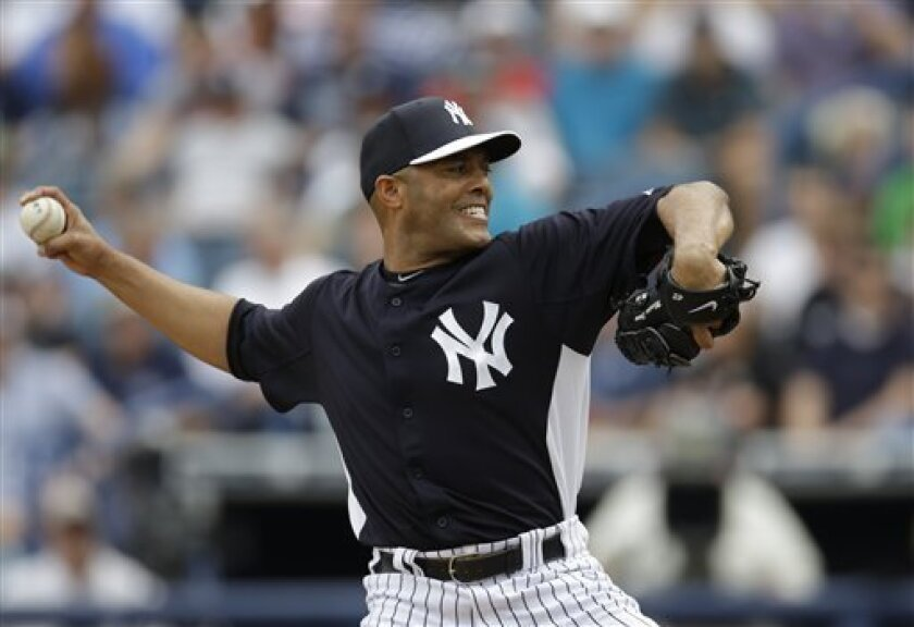 New York Yankees relief pitcher Mariano Rivera delivers against the Atlanta Braves during the fourth inning of a spring training baseball game at Steinbrenner Field in Tampa, Fla., Saturday, March 9, 2013. Rivera, who pitched a scoreless inning, announced his plans to retire at the end of the 2013 season on Saturday. (AP Photo/Kathy Willens)