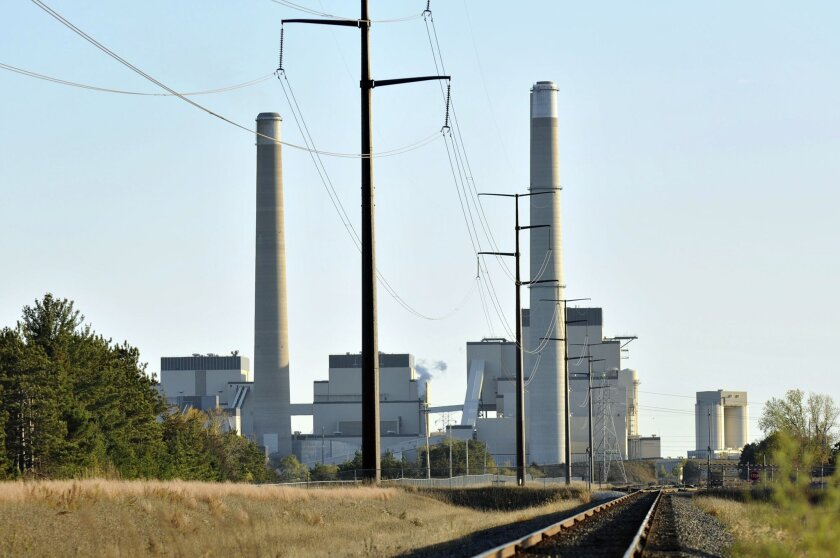 FILE - This Oct. 20, 2010, file photo, shows Xcel Energy's Sherco Power Plant  is shown in Becker, Minn. A divided Supreme Court agreed Feb. 9, 2016, to halt enforcement of President Barack Obama's sweeping plan to address climate change until after legal challenges are resolved. The surprising mov