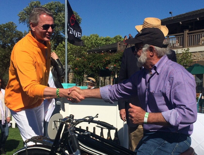 Event founder Gordon McCall congratulates local collector Robb Talbott on his Best in Show award at the 8th annual Quail Motorcycle Gathering in Carmel Valley.