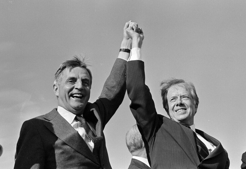 President Jimmy Carter and Vice President Walter Mondale clasp hands above their head