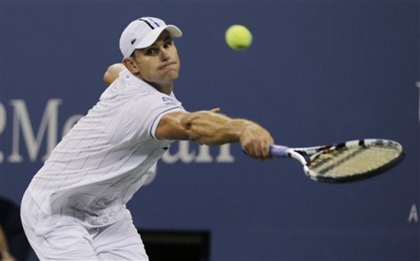 Andy Roddick returns a shot to Australia's Bernard Tomic in the third round of play at the 2012 US Open tennis tournament,  Friday, Aug. 31, 2012, in New York. (AP Photo/Charles Krupa)