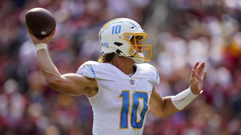 Chargers quarterback Justin Herbert throws against the Washington Football Team.