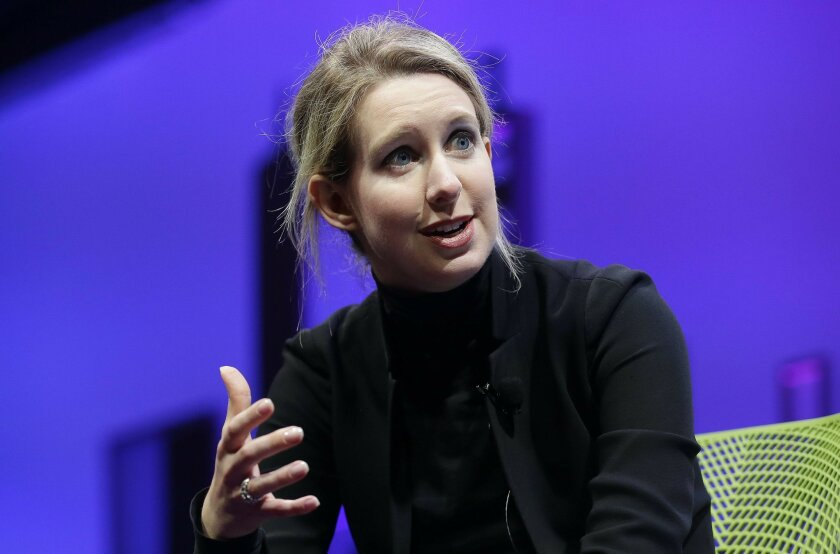 FILE - In this Nov. 2, 2016, file photo, Elizabeth Holmes, founder and CEO of Theranos, speaks at the Fortune Global Forum in San Francisco. Forbes announced on June 1, 2016, that it has revised its estimate of Holmes net worth from $4.5 billion to nothing. (AP Photo/Jeff Chiu, File)