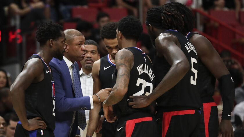 The LA Clippers meet on the bench with LA Clippers head coach Doc Rivers during the first half of an