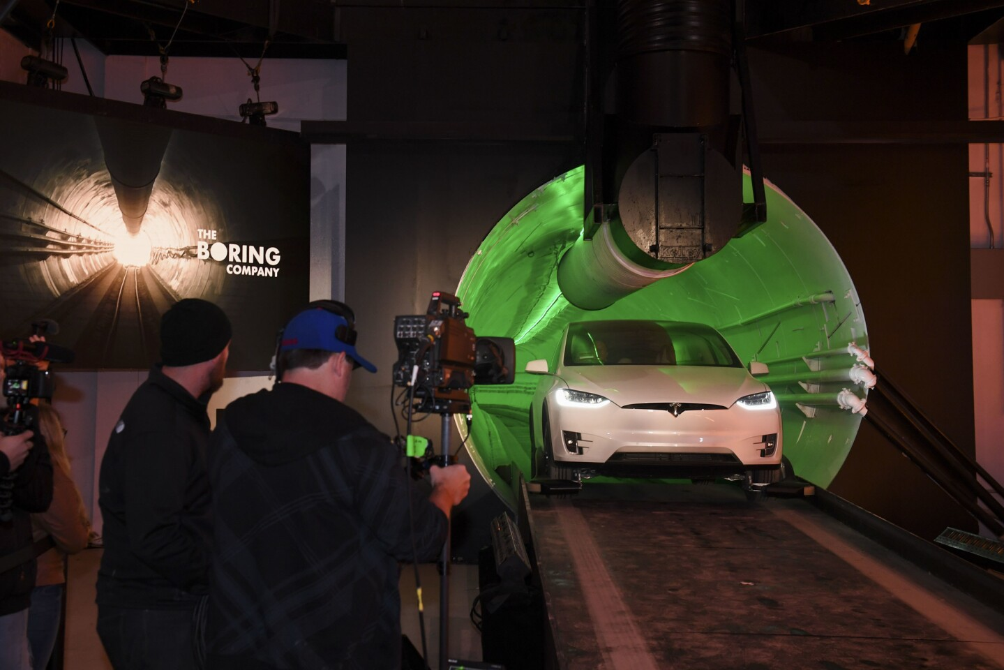 Elon Musk arrives in a modified Tesla Model X at an unveiling event for a test tunnel dug by Boring Co. in Hawthorne. Musk is chief executive of both Tesla and Boring Co.