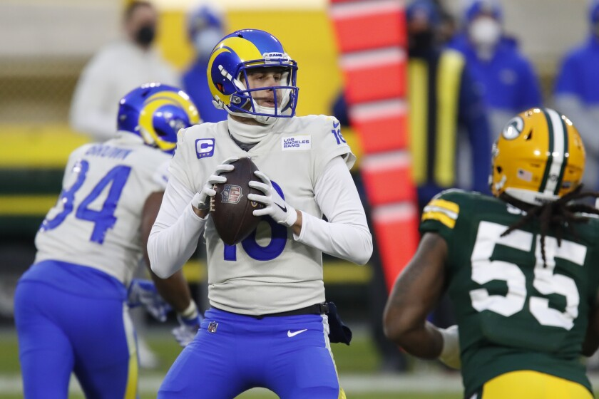 Quarterback Jared Goff (16) waits to pass for the Rams during the first half of an NFL divisional playoff Jan. 16, 2021.