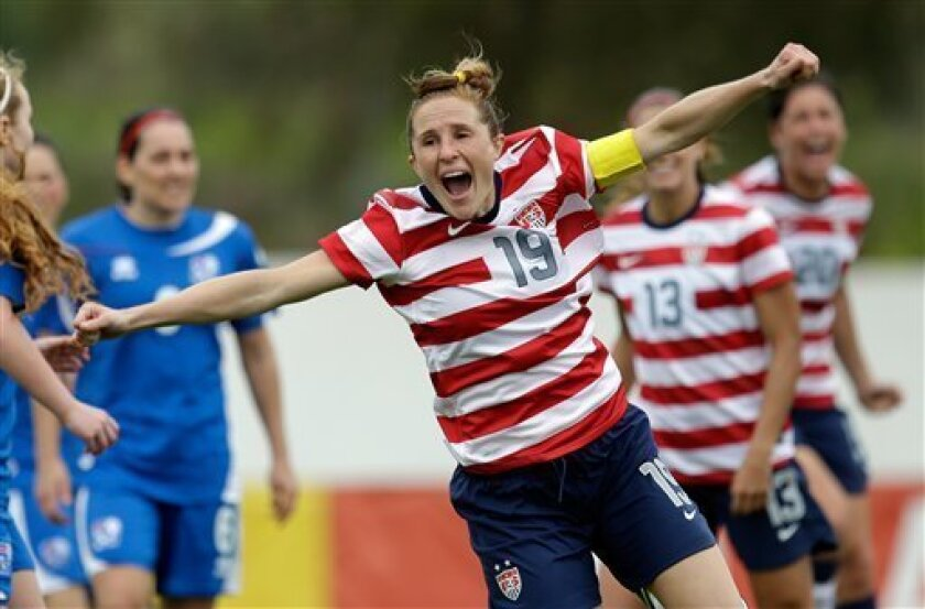 Rachel Buehler, of the US, celebrates after scoring the opening goal against Iceland during their Algarve Cup  women's soccer match Wednesday, March 6 2013, in Albufeira, southern Portugal. (AP Photo/Armando Franca)
