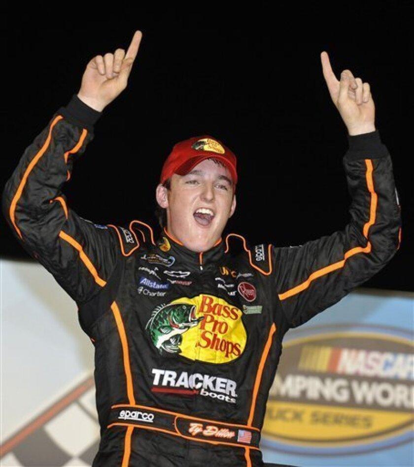 Ty Dillon celebrates in victory lane after winning the NASCAR Camping World Truck Series auto race at Atlanta Motor Speedway, Friday, Aug. 31, 2012, in Hampton, Ga. (AP Photo/Rainier Ehrhardt)