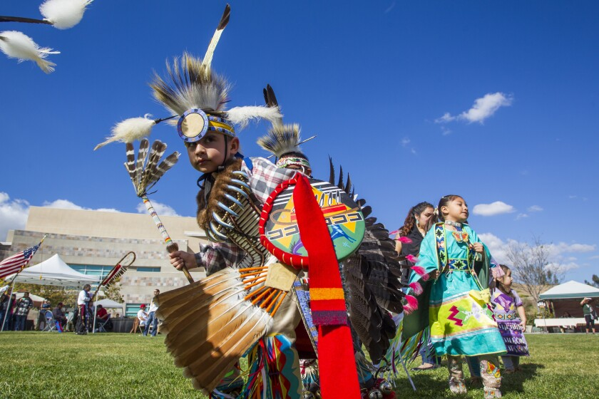 Dancers of all ages makes their way around the procession during the grand entry at Cuyamaca College's third annual powwow in 2017.