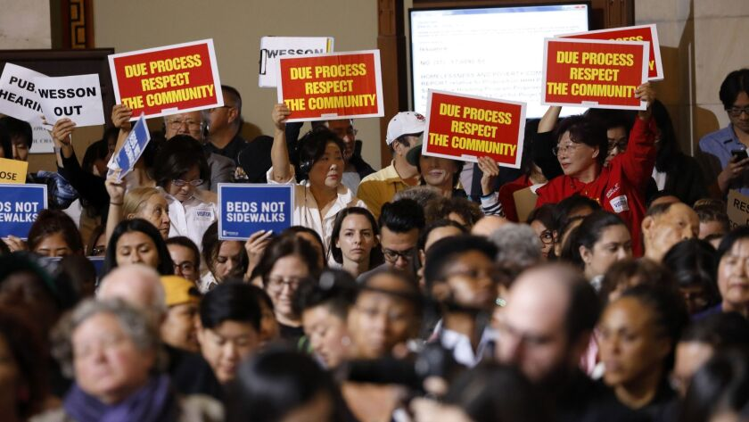 Residents of Koreatown protest a homeless shelter proposed by City Council President Herb Wesson at L.A. City Hall on June 29.