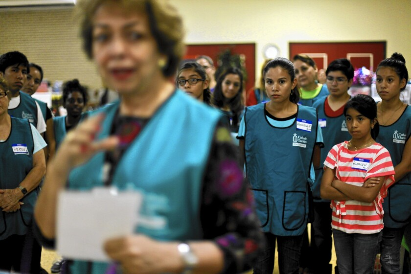 Volunteers receive an orientation at a church in Texas in July 2014. They had converged on south Texas to help immmigrants crossing the border.
