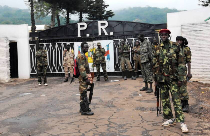 Rebel forces guard the presidential palace in Bangui, the capital of the Central African Republic, after seizing power.
