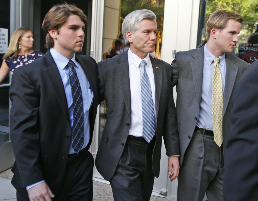 FILE - In a Friday, Aug. 29, 2014 file photo, former Virginia Gov. Bob McDonnell, center, leaves at Federal Court with his sons, Bobby, left, and Sean, right, in Richmond, Va. McDonnell's corruption case is expected to be in the jury's hands Tuesday, Sept. 1. (AP Photo/Steve Helber, File)