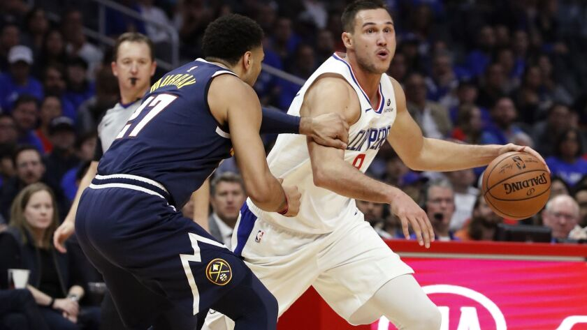 LOS ANGELES, CALIF. - OCT. 17, 2018. Clippers forward Danilo Galinari drives to the basket against N