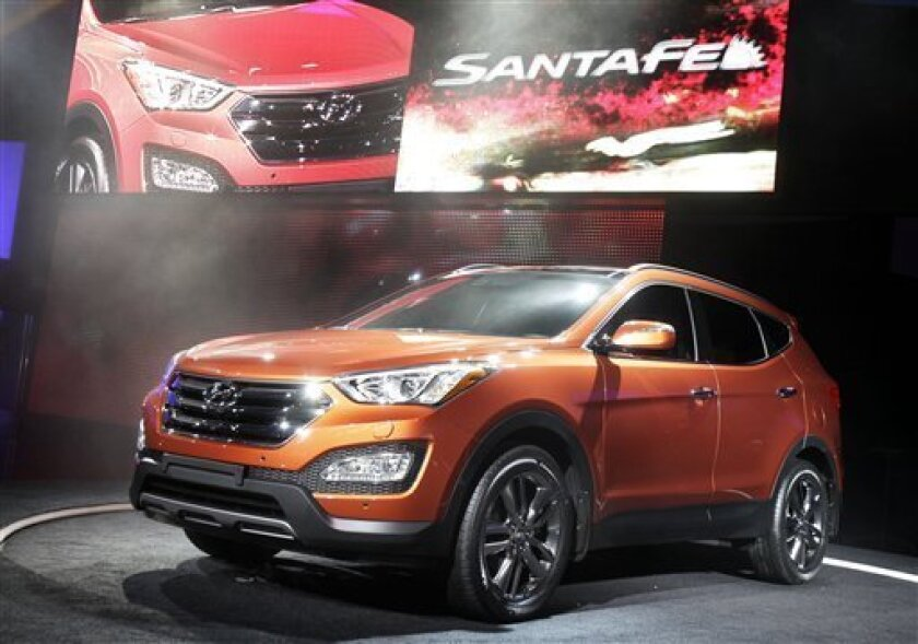 The 2013 Hyundai Santa Fe Sport is unveiled at the New York International Auto Show, in New York's Javits Center, Wednesday, April 4, 2012. (AP Photo/Richard Drew)
