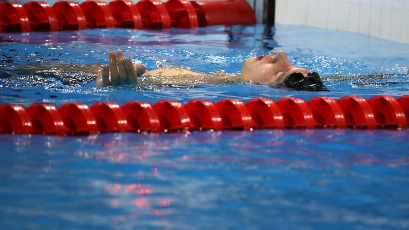 Chase Kalisz floats in the pool after finishing second in the 400-meter individual medley on Saturday night.