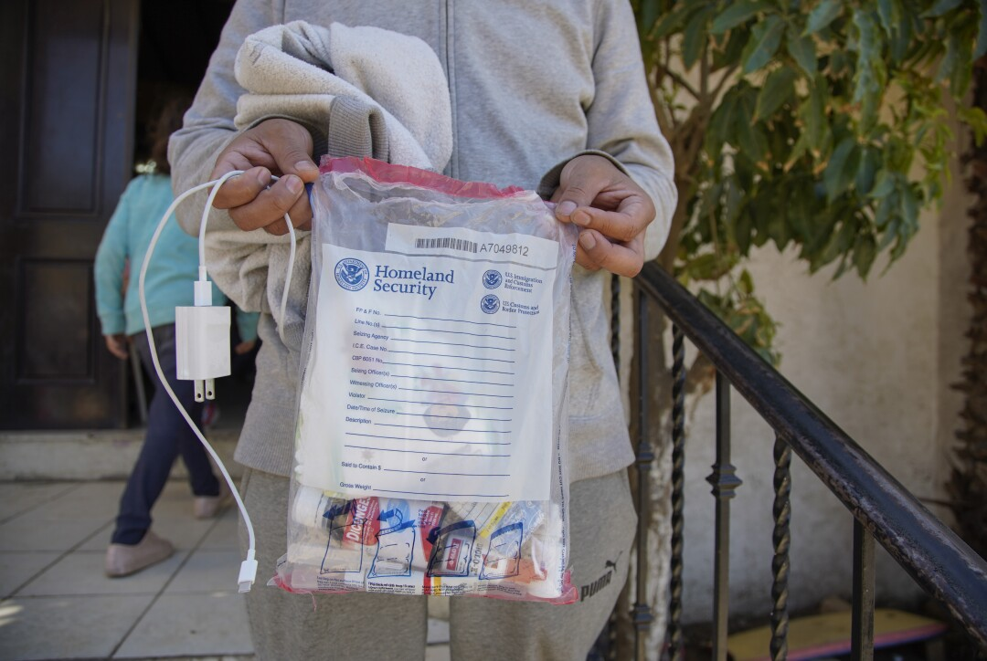 Asylum seekers arriving at the shelter come with a plastic bag for their belongings.