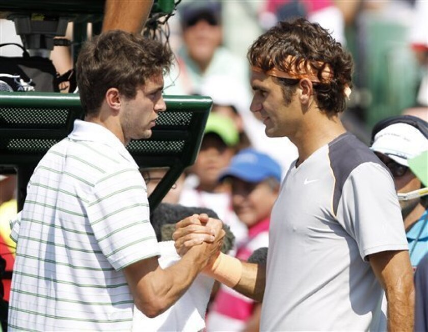 Gilles Simon, of France, left, congratulates Roger Federer, of Switzerland, after Simon retired form the match at the Sony Ericsson Open tennis tournament in Key Biscayne, Fla., Thursday, March 31, 2011. Federer won 3-0 by Gilles' retirement. (AP Photo/Alan Diaz)