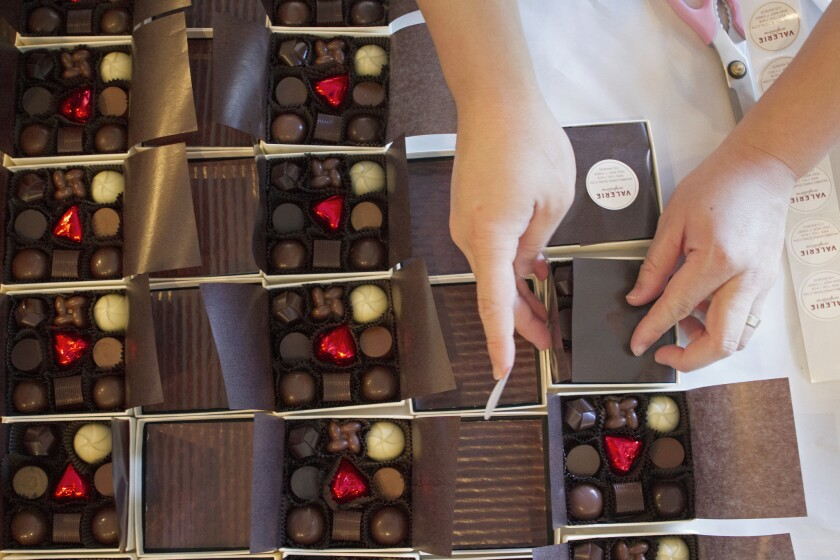Boxes of truffles being wrapped at Valerie Confections.