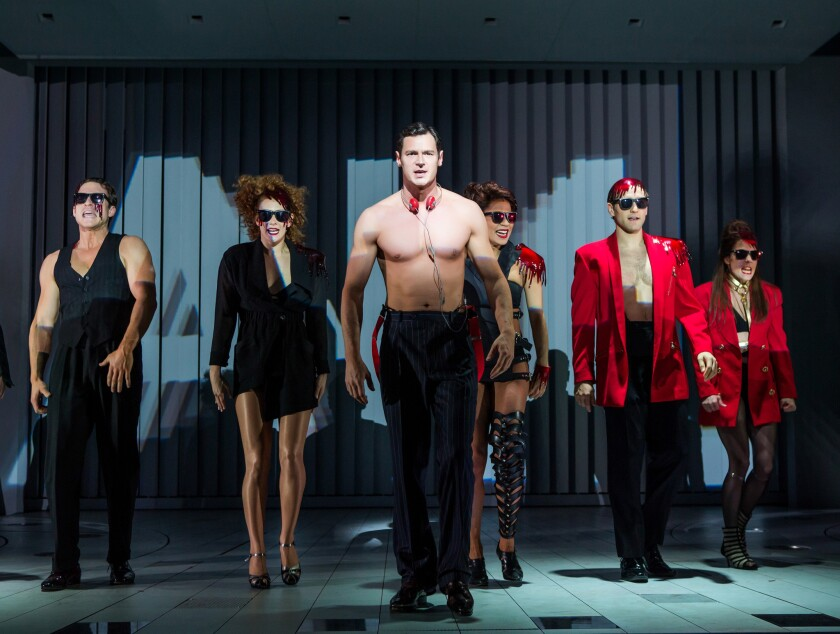 """Benjamin Walker, center, and the cast during a performance of """"American Psycho,"""" opening at the Gerald Schoenfeld Theatre in New York."""