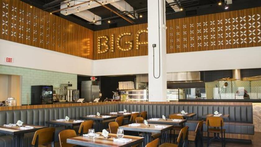 Italian food gets a fast-casual treatment at downtown's new Biga restaurant, now serving Neopolitan pies on the corner of Sixth Avenue and Broadway. The expansive restaurant allows guests to watch chefs at work and order their meals at the counter, with dishes including focaccia sandwiches, bruschetta, salads and wood-fired dishes such as fried polenta, local, pasture-raised porchetta, and Bolognese and parmesan bruschetta. 960 Sixth Ave. Suite C, downtown. bigasandiego.com (/ Courtesy photo)