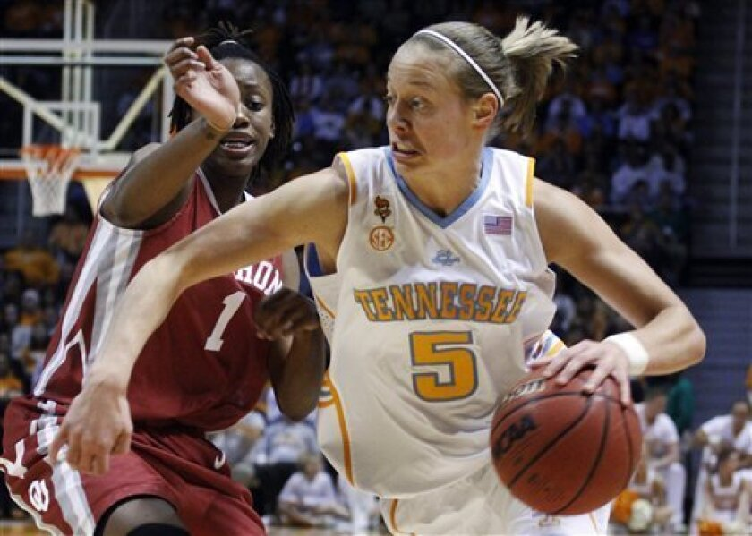 Tennessee's Angie Bjorklund (5) drives against Oklahoma's Nyeshia Stevenson (1) during the first half of an NCAA college basketball game Sunday, Jan. 3, 2010, in Knoxville, Tenn. (AP Photo/Wade Payne)