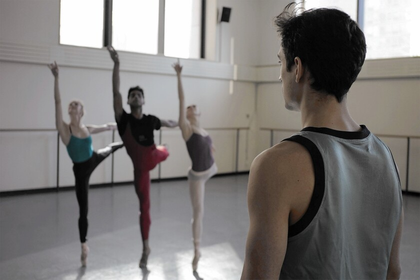 "In a scene from""Ballet 422,"" young dancer-choreographer Justin Peck watches performers' movements."