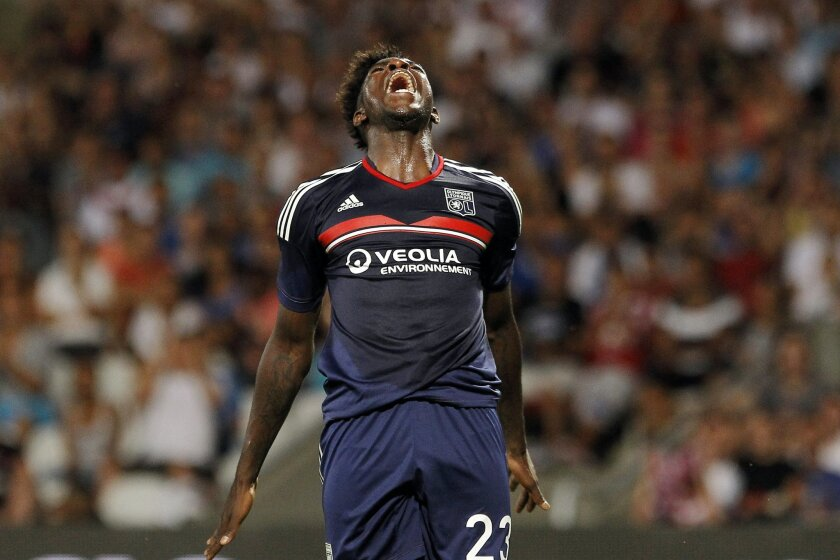 FILE - In this Tuesday July 30, 2013 file photo, Lyon's Samuel Umtiti reacts during a Champions League qualifying match against Grasshopper Zurich, in Lyon, France. Many nations are betting on youth at the European Championship, giving promising youngsters a chance to breakthrough in France. Some o